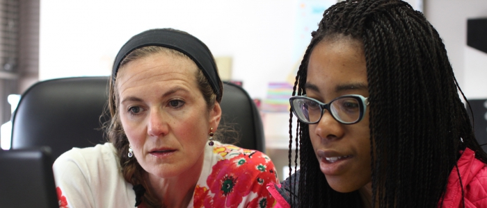 Associate Professor Amanda Godley and student Amanda Gamwo collaborating on research