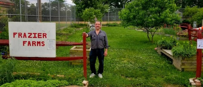 Mark Oleniacz of the South Oakland Neighborhood Group stands by the entryway to Frazier Farms, one of the community garden spaces run by his organization.
