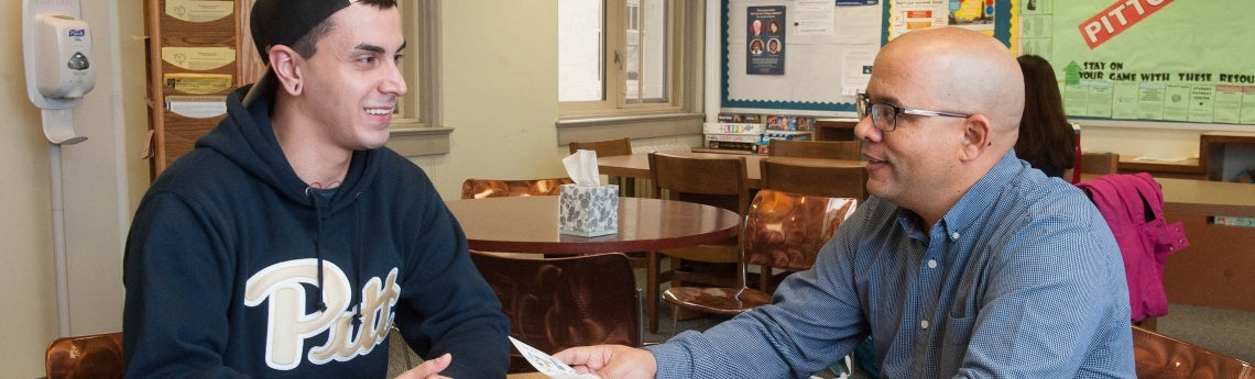 Advisor Gregory Allen meets with a student in the Advising Center.