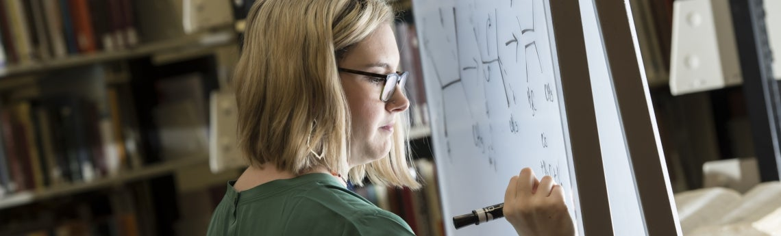 Photo of Elisabeth Ashmore studying chemistry in the Hilman Library.